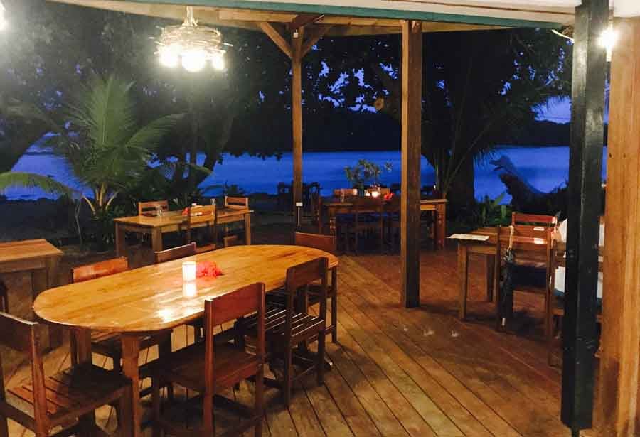 Restaurant at night overlooking the ocean at Turtle Bay Lodge